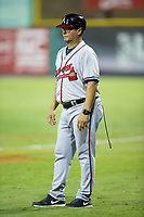 """Juan """"Porky"""" Lopez of the Danville Braves coaches first base during the game against the Burlington Royals at Burlington Athletic Stadium on August 15, 2017 in Burlington, North Carolina.  The Royals defeated the Braves 6-2.  (Brian Westerholt/Four Seam Images)"""