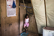 Ernesto Betasolo's daughter Angelene Betasolo (10) seen in their house in Relocation Golden Valley in Barangay Pagkakaisa outside of Puerto Princesa, Palawan in the Philippines. <br /> Photo: Sanjit Das/Panos for Greenpeace