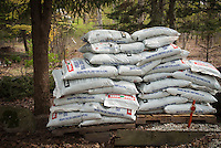 Bags of organic pine soil conditioner to amend to garden, transitioning to gardening organically, soil enrichment, amending and fertilizing