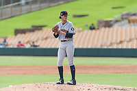 Scottsdale Scorpions starting pitcher Forrest Whitley (11), of the Houston Astros organization, gets ready to deliver a pitch during an Arizona Fall League game against the Glendale Desert Dogs at Camelback Ranch on October 16, 2018 in Glendale, Arizona. Scottsdale defeated Glendale 6-1. (Zachary Lucy/Four Seam Images)