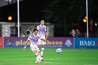LAKE BUENA VISTA, FL - AUGUST 06: Mauricio Pereyra #10 of Orlando City SC kicks the ball during a game between Orlando City SC and Minnesota United FC at ESPN Wide World of Sports on August 06, 2020 in Lake Buena Vista, Florida.