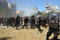 Police retreats escaping from a  rain of stones thrown by rioters during severe clashes  while near the Congress building while Deputies Chamber was   discussing changes in   retirement legislation