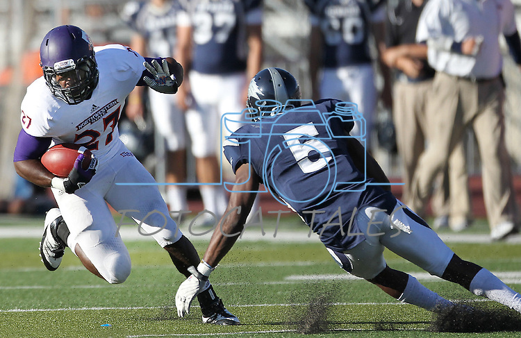 Northwestern State's Sidney Riley (27) jukes past Nevada's Duke Williams (5) during the first half of an NCAA college football game Saturday, Sept. 15, 2012, in Reno, Nev. (AP Photo/Cathleen Allison)