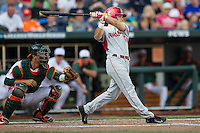 Arkansas Razorbacks outfielder Andrew Benintendi (16) swings the bat during the NCAA College baseball World Series against the Miami Hurricanes on June 15, 2015 at TD Ameritrade Park in Omaha, Nebraska. Miami beat Arkansas 4-3. (Andrew Woolley/Four Seam Images)