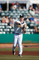 Charleston RiverDogs third baseman Ben Troike (11) makes a throw to first base against the Down East Wood Ducks at Joseph P. Riley, Jr. Park on September 26, 2021 in Charleston, South Carolina. (Brian Westerholt/Four Seam Images)