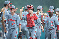 North Carolina State Wolfpack catcher Patrick Bailey (5) high fives his teammates following the win over the Northeastern Huskies at Doak Field at Dail Park on June 2, 2018 in Raleigh, North Carolina. The Wolfpack defeated the Huskies 9-2. (Brian Westerholt/Four Seam Images)