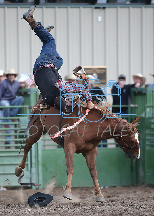 A competitor gets thrown off during the ranch bronc riding portion of the Smackdown Bull Riding event at Fuji Park Fairgrounds in Carson City, Nev., on Friday, June 5, 2015. The event continues Saturday night at 6 p.m. Tickets are $12 and available in advance from Casino Fandango and the Carson City Visitors Bureau or at the gate.  <br /> Photo by Cathleen Allison/Nevada Photo Source