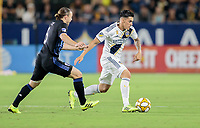 CARSON, CA - SEPTEMBER 21: Cristian Pavon #10 of the Los Angeles Galaxy dribbles the ball during a game between Montreal Impact and Los Angeles Galaxy at Dignity Health Sports Park on September 21, 2019 in Carson, California.