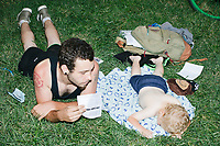 Tyler Martel, of Manchester, NH, fans his sleeping son Caleb, while sitting in the shade listening to speakers in the protest area in FDR Park outside of the secure area surrounding the Democratic National Convention at the Wells Fargo Center in Philadelphia, Pennsylvania, on Wed., July 27, 2016.