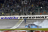 Monster Energy NASCAR Cup Series<br /> Go Bowling 400<br /> Kansas Speedway, Kansas City, KS USA<br /> Saturday 13 May 2017<br /> Martin Truex Jr, Furniture Row Racing, Auto-Owners Insurance Toyota Camry celebrates his win with a burnout<br /> World Copyright: Nigel Kinrade<br /> LAT Images<br /> ref: Digital Image 17KAN1nk10352