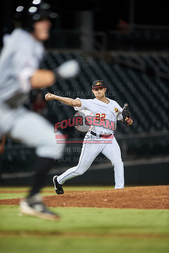 Mesa Solar Sox relief pitcher Will Vest (22), of the Detroit Tigers organization, throws to first base during an Arizona Fall League game against the Peoria Javelinas on September 21, 2019 at Sloan Park in Mesa, Arizona. Mesa defeated Peoria 4-1. (Zachary Lucy/Four Seam Images)