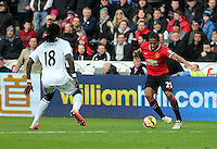 SWANSEA, WALES - FEBRUARY 21: Antonio Valencia of Manchester (R) against Bafetimbi Gomis (L) of Swansea during the Barclays Premier League match between Swansea City and Manchester United at Liberty Stadium on February 21, 2015 in Swansea, Wales.