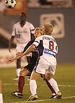 DALLAS, TX -SEPTEMBER 14: Bobby Rhine #19 of the Dallas Burn in action against Joe Franchino #8 of New England Revolution at Cotton Bowl in Dallas on September 14, 2002 in Dallas, Texas. (Photo by Rick Yeatts) Rhine's career consisted of 212 games making 136 starts, played more than 12,000 minutes scoring 23 goals and 34 recorded assists.