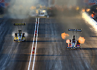 Feb 21, 2014; Chandler, AZ, USA; NHRA top fuel dragster driver Clay Millican (right) races alongside Richie Crampton during qualifying for the Carquest Auto Parts Nationals at Wild Horse Pass Motorsports Park. Mandatory Credit: Mark J. Rebilas-USA TODAY Sports