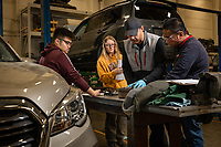 Automotive Technology instructor Randal Smith teaches his brake systems (ADT A150) course in UAA's Automotive and Diesel Technology Building. From left: student Angelo Lotino, student Hannah Thayer, instructor Randal Smith, and student Johan Nuesca.