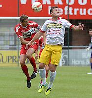 FC Gullegem - KV Kortrijk : kopduel tussen Nebojsa Pavlovic (links) en Nicolas Gezelle (r) <br /> foto VDB / BART VANDENBROUCKE