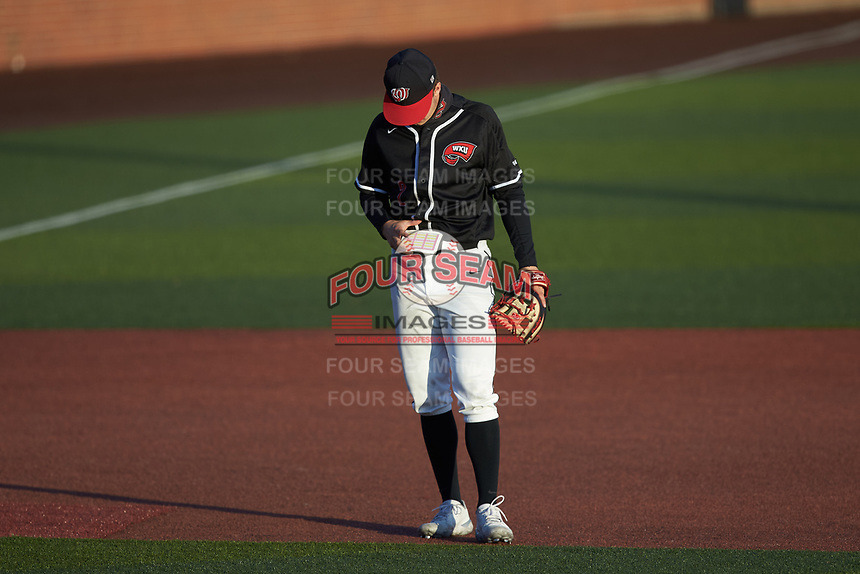 Western Kentucky Hilltoppers third baseman Matthew Meyer (2) checks his cheat sheet for the play call during the game against the Valparaiso Crusaders at Nick Denes Field on March 19, 2021 in Bowling Green, Kentucky. (Brian Westerholt/Four Seam Images)