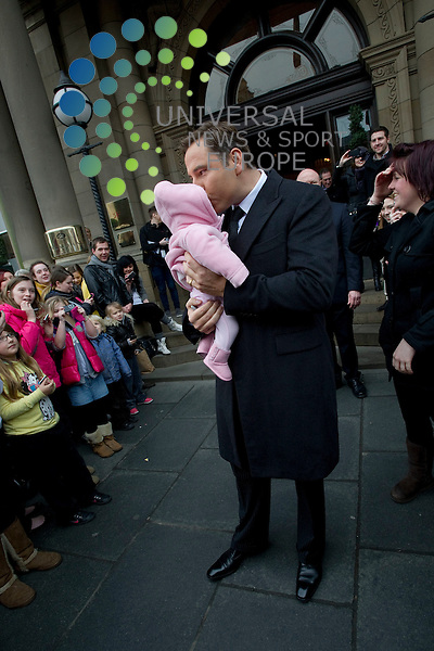 Britains Got Talent judges leaving the Balmoral Hotel and head for the Festival Theatre, Edinburgh, Scotalnd, 11th February, 2012 . Pictured David Walliams pretends to steal a baby from a member of the crowd..Picture:Scott Taylor Universal News And Sport (Europe) .All pictures must be credited to www.universalnewsandsport.com. (Office)0844 884 51 22.
