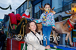 Una O'Donoghue and Abbie Killarney enjoying Santa's sleigh on Sunday