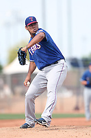 Wilmer Font #53 of the Texas Rangers pitches during a Minor League Spring Training Game against the Kansas City Royals at the Kansas City Royals Spring Training Complex on March 20, 2014 in Surprise, Arizona. (Larry Goren/Four Seam Images)