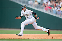 Trayce Thompson (15) of the Charlotte Knights takes off for second base during the game against the Norfolk Tides at BB&T BallPark on June 7, 2015 in Charlotte, North Carolina.  The Tides defeated the Knights 4-1.  (Brian Westerholt/Four Seam Images)