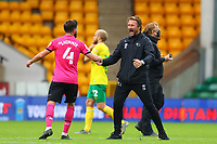 3rd October 2020; Carrow Road, Norwich, Norfolk, England, English Football League Championship Football, Norwich versus Derby; Derby County Manager Phillip Cocu celebrates the 0-1 win with Graeme Shinnie