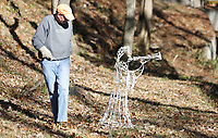 Monty Henderson checks the location Monday, November 16, 2020, of an angel decoration in his yard off of Old Missouri Road in Fayetteville. Henderson has been using the same decorations for 25 years and said he only has to change the occasional light bulb. Check out nwaonline.com/201117Daily/ and nwadg.com/photos for a photo gallery.(NWA Democrat-Gazette/David Gottschalk)