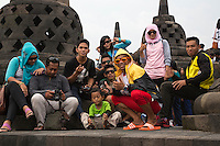 Borobudur, Java, Indonesia.  Indonesian Visitors to the Temple Posing for their Picture.