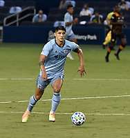 KANSAS CITY, KS - AUGUST 25: Alan Pulido #9 of Sporting Kansas City dribbles the ball up field during a game between Houston Dynamo and Sporting Kansas City at Children's Mercy Park on August 25, 2020 in Kansas City, Kansas.