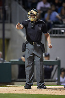 Home plate umpire Richard Riley makes a strike call during the International League game between the Scranton/Wilkes-Barre RailRiders and the Charlotte Knights at BB&T BallPark on April 12, 2018 in Charlotte, North Carolina.  The RailRiders defeated the Knights 11-1.  (Brian Westerholt/Four Seam Images)
