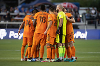 SAN JOSE, CA - JULY 24: Houston Dynamo players huddle at the start of the second half during a game between San Jose Earthquakes and Houston Dynamo at PayPal Park on July 24, 2021 in San Jose, California.