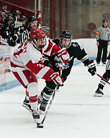 BOSTON, MA - JANUARY 11: Abbey Stanley #21 of Boston University passes the puck as Isabelle Hardy #21 of Providence College defends during a game between Providence College and Boston University at Walter Brown Arena on January 11, 2020 in Boston, Massachusetts.