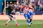 Angel Correa of Atletico de Madrid (R) in action against David Garcia Zubiria of Osasuna (L) during the La Liga match between Atletico de Madrid vs Osasuna at the Estadio Vicente Calderon on 15 April 2017 in Madrid, Spain. Photo by Diego Gonzalez Souto / Power Sport Images