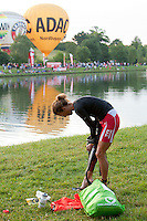 Chrissie Wellington prepares herself just before the swim start at the Challenge Roth Ironman Triathlon, Roth, Germany, 10 July 2011