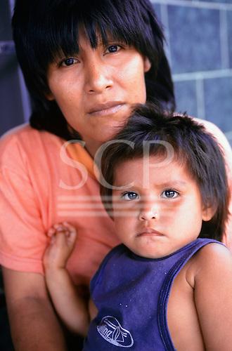 Altamira, Brazil. Arara Indian woman and child at the Casa do Indio FUNAI house.