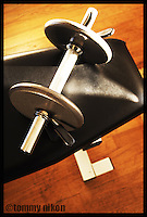Dumbbell resting on weight bench