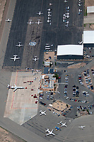 aerial photograph of the Santa Fe Regional Airport (SAF), Santa Fe, New Mexico showing the main terminal aerial, the tower and the two fixed base operators, the Jet Center and Signature