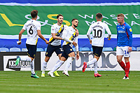 Marcus Browne of Oxford United middle ids congratulated after scoring to make the score 1-1 during Portsmouth vs Oxford United, Sky Bet EFL League 1 Play-Off Semi-Final Football at Fratton Park on 3rd July 2020