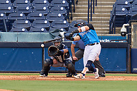 Tampa Tarpons third baseman Andres Chaparro (24) bats during a game against the Lakeland Flying Tigers on July 18, 2021 at George M. Steinbrenner Field in Tampa, Florida.  Also shown catcher Gresuan Silverio (51).  (Mike Janes/Four Seam Images)
