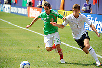 Jose Antonio Castro (15) of Mexico (MEX) and Robbie Rogers (7) of the United States (USA). Mexico (MEX) defeated the United States (USA) 5-0 during the finals of the CONCACAF Gold Cup at Giants Stadium in East Rutherford, NJ, on July 26, 2009.