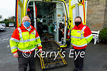 Volunteers with Order of Malta Killarney getting ready to transport a patient from the Bons Secours hospital in Tralee on Tuesday. L to r: Michael Fleming and Clare Looney.