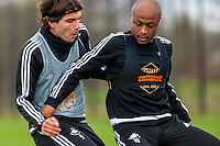Tuesday 19 April 2016<br /> Pictured:  ( L-R ) Alberto Paloschi of Swansea City and Andre Ayew of Swansea City  in action during training.<br /> Re: Swansea City Training Session ahead of the away game against Leicester City FC