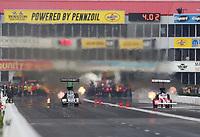 Apr 13, 2019; Baytown, TX, USA; NHRA top fuel driver Leah Pritchett (left) races alongside Doug Kalitta during qualifying for the Springnationals at Houston Raceway Park. Mandatory Credit: Mark J. Rebilas-USA TODAY Sports