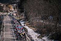 peloton passing some snow banks<br /> <br /> 76th Paris-Nice 2018<br /> stage 6: Sisteron > Vence (198km)