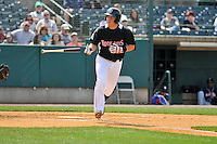 Pat Valaika (12) of the New Britain Rock Cats walks during a game between the New Britain Rock Cats and the New Hampshire Fisher Cats at New Britain Stadium on April 19, 2015 in New Britain, Connecticut.<br /> (Gregory Vasil/Four Seam Images)