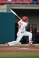 Evan Mendoza (18) of the North Carolina State Wolfpack follows through on his swing against the Louisville Cardinals at Doak Field at Dail Park on March 24, 2017 in Raleigh, North Carolina. The Wolfpack defeated the Cardinals 3-1. (Brian Westerholt/Four Seam Images)