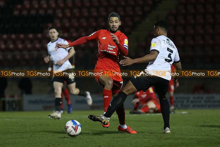 Jobi McAnuff of Leyton Orient and Ibou Touray of Salford City during Leyton Orient vs Salford City, Sky Bet EFL League 2 Football at The Breyer Group Stadium on 2nd January 2021
