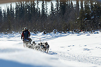 Nathan Schroeder runs on a slough after leaving Galena in the morning on Friday March 13, 2015 during Iditarod 2015.  <br /> <br /> (C) Jeff Schultz/SchultzPhoto.com - ALL RIGHTS RESERVED<br />  DUPLICATION  PROHIBITED  WITHOUT  PERMISSION