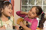 Education Preschool 4 year olds two girls in dressup clothes interacting, happy