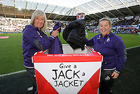 Sue Eames with a Give A Jack a Jacket box during the Premier League match between Swansea City and Manchester United at The Liberty Stadium, Swansea, Wales, UK. Sunday 06 November 2016